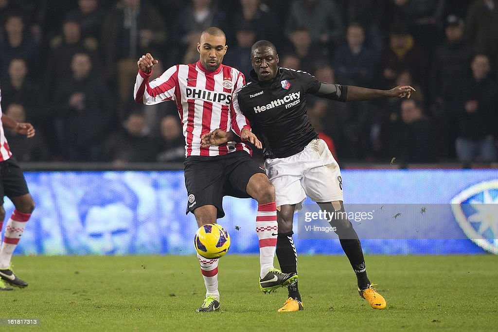 Orlando Engelaar of PSV, Jacob Mulenga of FC Utrecht during the Dutch Eredivisie match between PSV Eindhoven and FC Utrecht at the Philips Stadium on february 16, 2013 in Eindhoven, The Netherlands