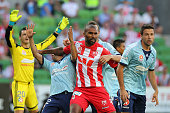 Orlando Engelaar of the Heart competes with the Sydney FC defence during the round 17 ALeague match between Melbourne Heart and Sydney FC at AAMI...