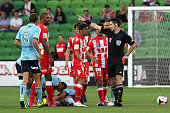 Orlando Engelaar of the Heart is given a red card by the referee following a tackle on Hagi Gligor of Sydney FC during the round 17 ALeague match...