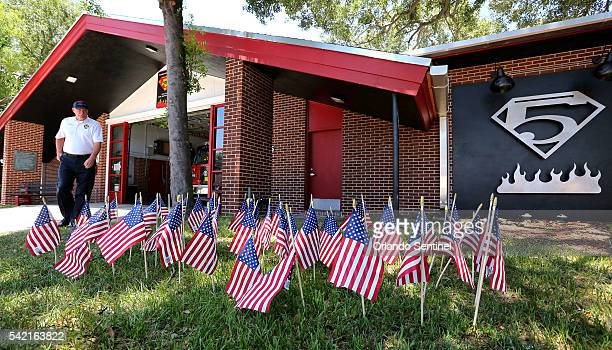 Orlando Fire Dept Lt Davis O'Dell walks among the 49 flags posted in front of Fire Station 5 to honor the victims of the Pulse massacre on Wednesday...