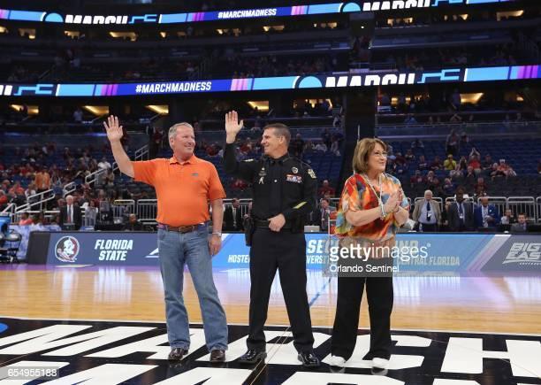 Orlando Fla mayor Buddy Dyer police chief John Mina and Orange County mayor Teresa Jacobs share a moment dedicated to Pulse nighclub victims before...
