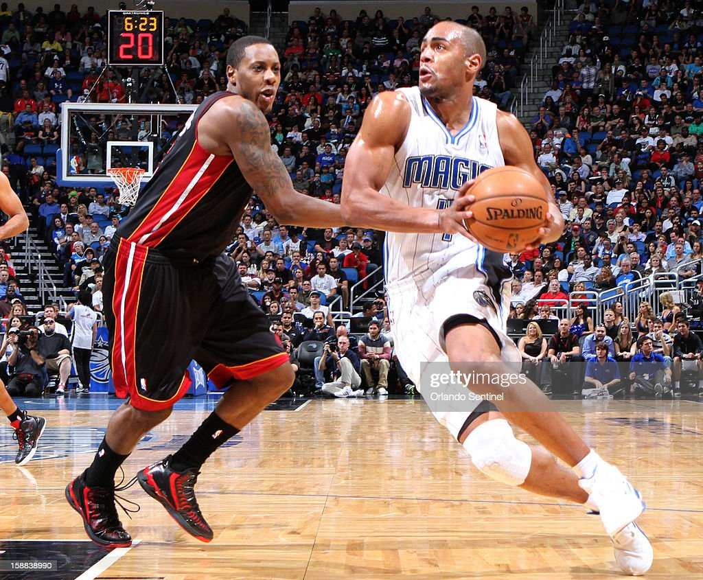 Orlando forward Arron Afflalo (4) drives against Miami guard Mario Chalmers (15) during the first half of the Magic's game against the Heat in Orlando, Florida on Monday, December 31, 2012.