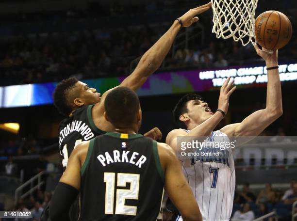 Orlando forward Ersan Ilyasova lays in a shot against Milwaukee Bucks forwards Giannis Antetokounmpo and Jabari Parker on Monday April 11 at the...
