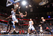 Orlando guard Arron Afflalo puts in a reverse layup between Chicago's Jimmy Butler and Taj Gibson during the first half of the Magic's game against...