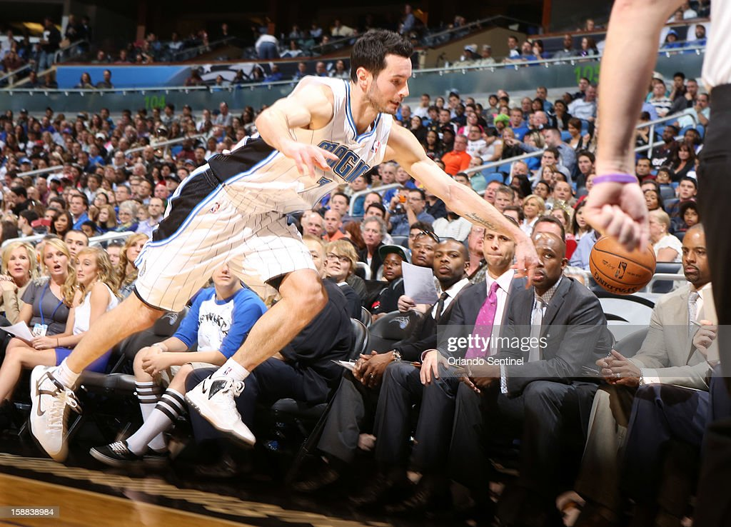 Orlando guard J.J. Redick (7) dives for a ball going out of bounds during the first half of the Magic's game against the Miami Heat in Orlando, Florida on Monday, December 31, 2012.