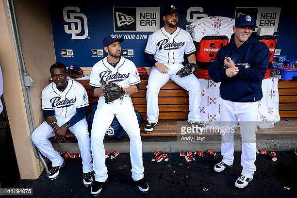 Orlando Hudson Jason Bartlett Yonder Alonso and Blake Tekotte of the San Diego Padres wait in the dogout for the start of the game against the Miami...