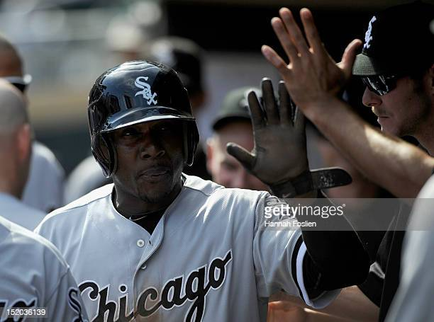 Orlando Hudson of the Chicago White Sox celebrates scoring against the Minnesota Twins during the ninth inning on September 15 2012 at Target Field...