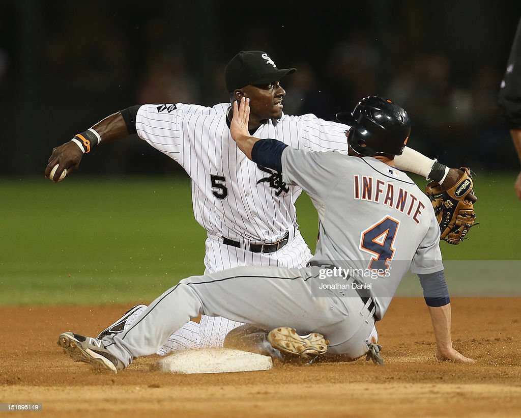 Orlando Hudson of the Chicago White Sox completes a double play by throwing to 1st base from his knees as Omar Infante of the Detroit Tigers slides...