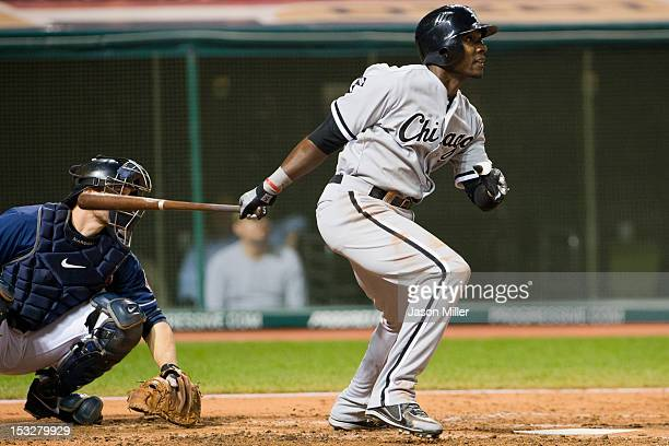 Orlando Hudson of the Chicago White Sox hits an RBI single during the sixth inning against the Cleveland Indians at Progressive Field on October 2...