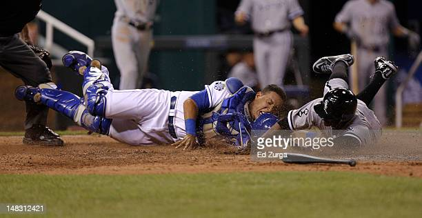 Orlando Hudson of the Chicago White Sox is tagged out at home by Salvador Perez of the Kansas City Royals as he tries to score on a AJ Pierzynski...