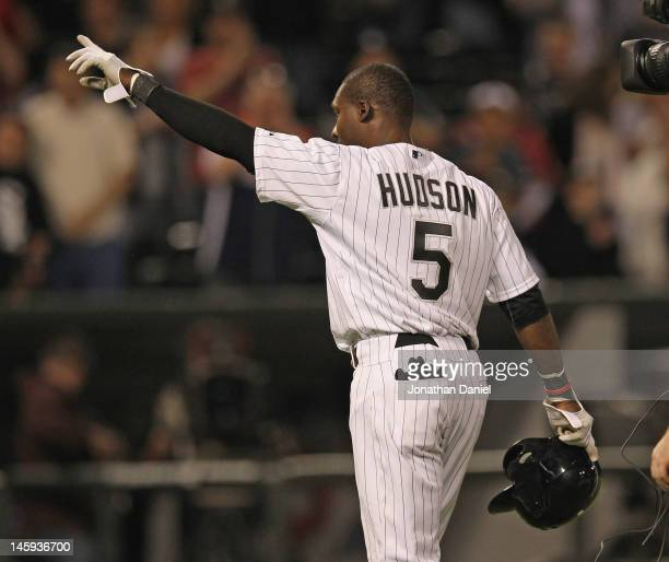 Orlando Hudson of the Chicago White Sox points to the crowd after getting the gamewinning hit in the bottom of the 9th inning against the Toronto...
