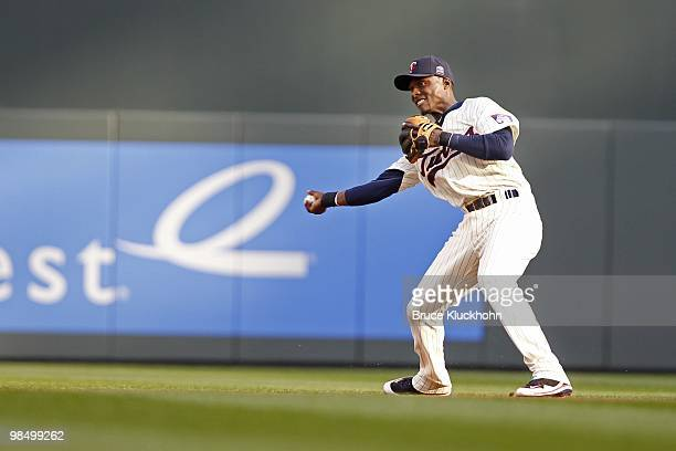 Orlando Hudson of the Minnesota Twins throws to second base to put out the Boston Red Sox on April 12 2010 at Target Field in Minneapolis Minnesota...