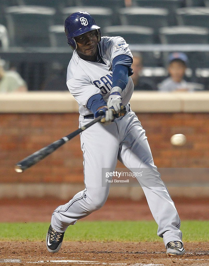 Orlando Hudson #1 of the San Diego Padres hits an RBI double during the fourth inning of a Major League Baseball game against the New York Mets at Citi Field on August 9, 2011 in the Flushing neighborhood of the Queens borough of New York City.