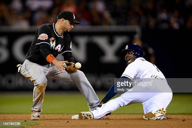 Orlando Hudson of the San Diego Padres is safe at second base against Omar Infante of the Miami Marlins at Petco Park on May 4 2012 in San Diego...
