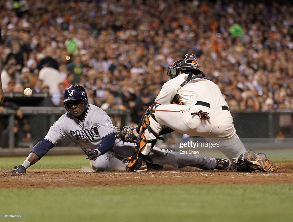 <a gi-track='captionPersonalityLinkClicked' href=/galleries/search?phrase=Orlando+Hudson&family=editorial&specificpeople=203242 ng-click='$event.stopPropagation()'>Orlando Hudson</a> #1 of the San Diego Padres scored when the ball got away from Chris Stewart #37 of the San Francisco Giants in the seventh inning at AT&T Park on August 23, 2011 in San Francisco, California.