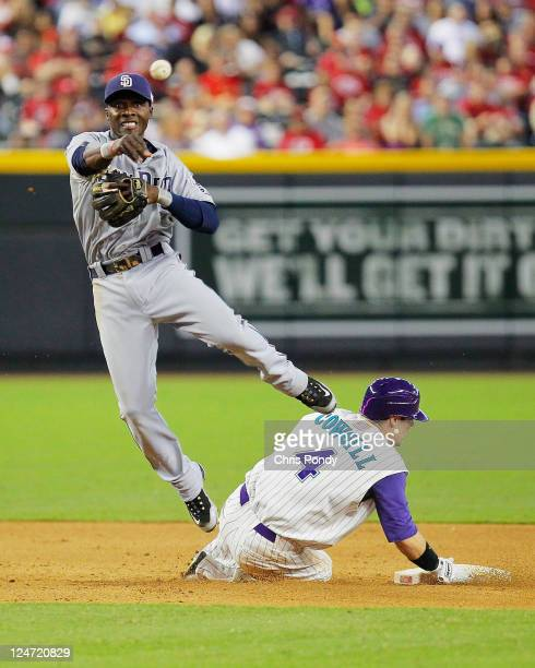 Orlando Hudson of the San Diego Padres throws over a sliding Collin Cowgill of the Arizona Diamondbacks during the MLB game at Chase Field on...