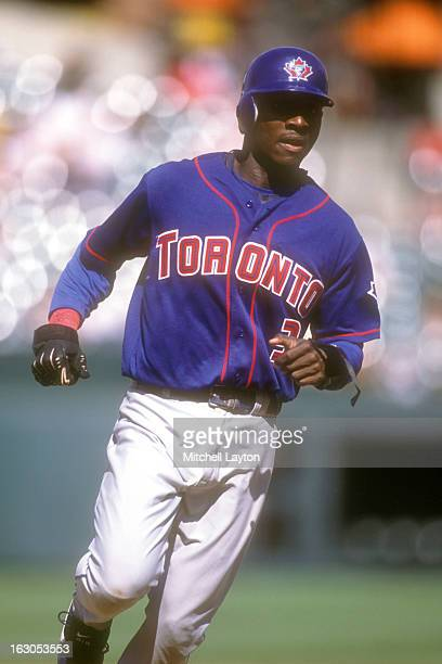 Orlando Hudson of the Toronto Blue Jays runs to third base during a baseball game against the Baltimore Orioles on August 23 2002 at Camden Yards in...