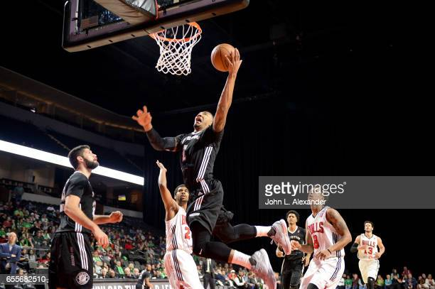 Orlando Johnson of the Austin Spurs drives to the basket and shoots the ball against the Windy City Bulls during a NBA DLeague game on March 17 2017...