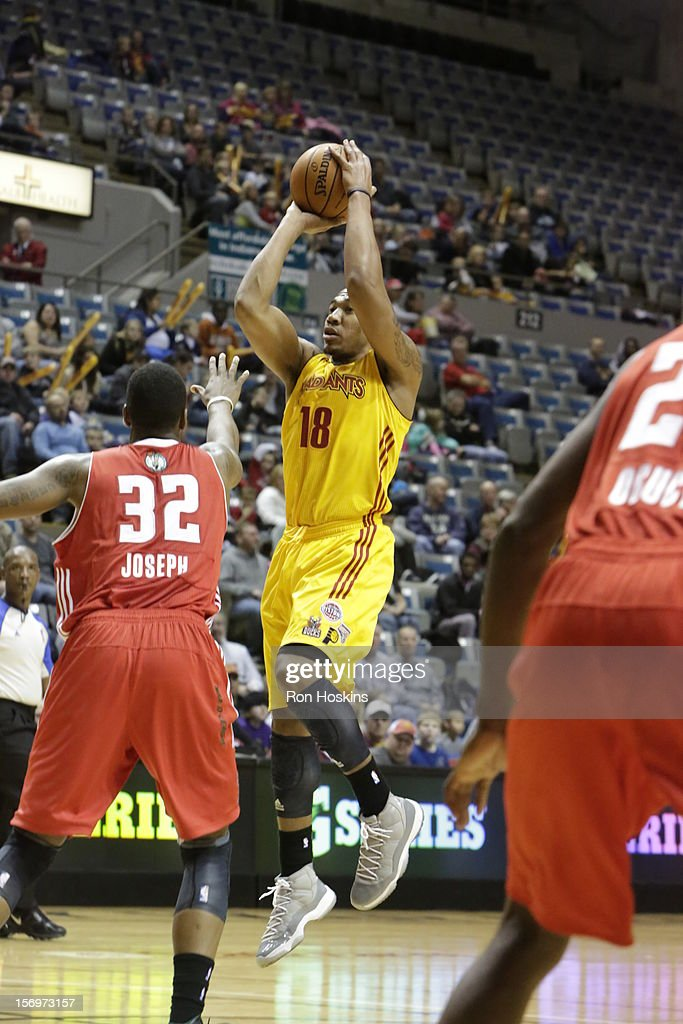 Orlando Johnson of the Fort Wayne Mad Ants shoots over Kris Joseph of the Maine Red Claws at Allen County Memorial Coliseum on November 25 2010 in...