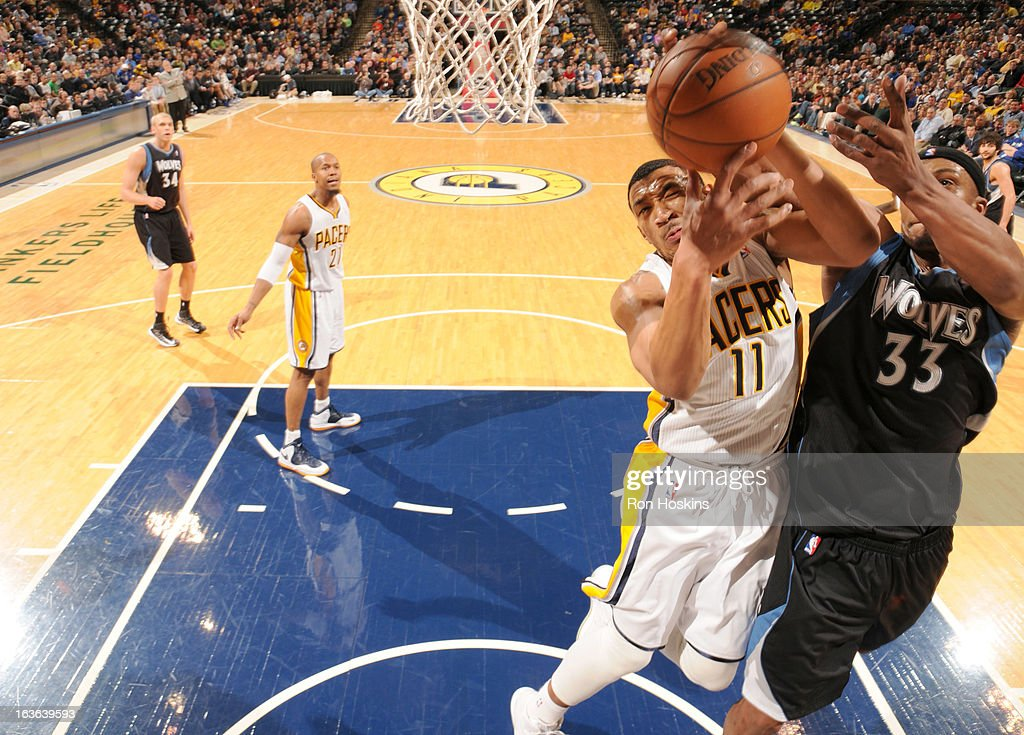 <a gi-track='captionPersonalityLinkClicked' href=/galleries/search?phrase=Orlando+Johnson&family=editorial&specificpeople=6849358 ng-click='$event.stopPropagation()'>Orlando Johnson</a> #11 of the Indiana Pacers battle for the ball control with <a gi-track='captionPersonalityLinkClicked' href=/galleries/search?phrase=Dante+Cunningham&family=editorial&specificpeople=683729 ng-click='$event.stopPropagation()'>Dante Cunningham</a> #33 of the Minnesota Timberwolves during the game between the Indiana Pacers and the Minnesota Timberwolves on March 13, 2013 at Bankers Life Fieldhouse in Indianapolis, Indiana.
