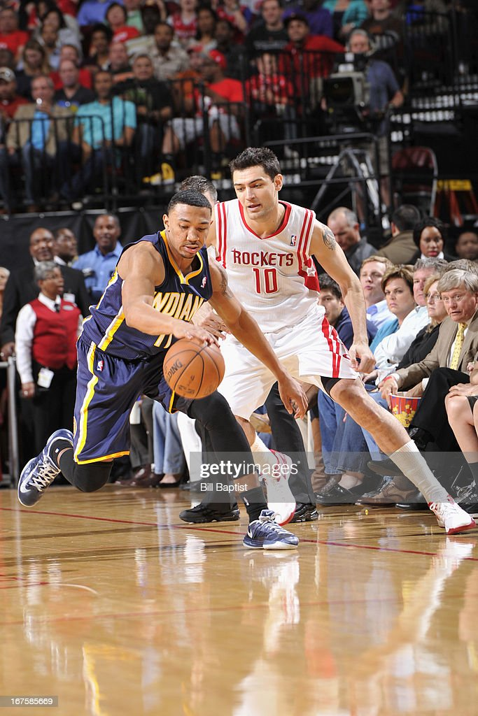 <a gi-track='captionPersonalityLinkClicked' href=/galleries/search?phrase=Orlando+Johnson&family=editorial&specificpeople=6849358 ng-click='$event.stopPropagation()'>Orlando Johnson</a> #11 of the Indiana Pacers chases down a loose ball against <a gi-track='captionPersonalityLinkClicked' href=/galleries/search?phrase=Carlos+Delfino&family=editorial&specificpeople=206625 ng-click='$event.stopPropagation()'>Carlos Delfino</a> #10 of the Houston Rockets on March 27, 2013 at the Toyota Center in Houston, Texas.