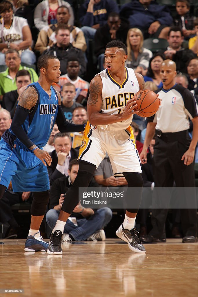<a gi-track='captionPersonalityLinkClicked' href=/galleries/search?phrase=Orlando+Johnson&family=editorial&specificpeople=6849358 ng-click='$event.stopPropagation()'>Orlando Johnson</a> #11 of the Indiana Pacers controls the ball against <a gi-track='captionPersonalityLinkClicked' href=/galleries/search?phrase=Monta+Ellis&family=editorial&specificpeople=567403 ng-click='$event.stopPropagation()'>Monta Ellis</a> #11 of the Dallas Mavericks at Bankers Life Fieldhouse on October 16, 2013 in Indianapolis, Indiana.