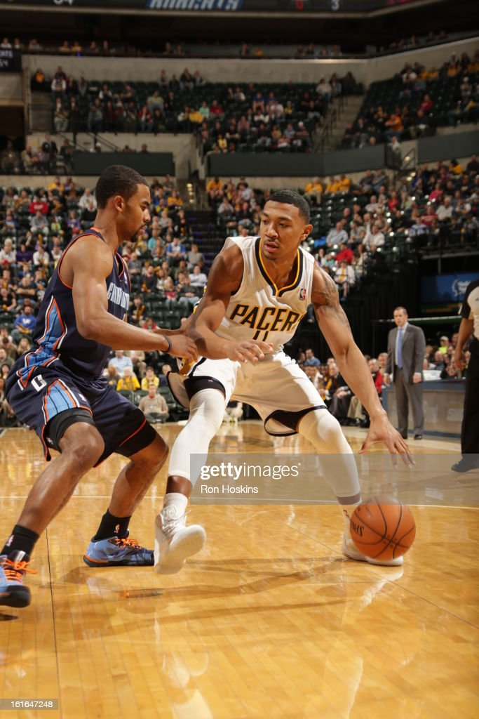 <a gi-track='captionPersonalityLinkClicked' href=/galleries/search?phrase=Orlando+Johnson&family=editorial&specificpeople=6849358 ng-click='$event.stopPropagation()'>Orlando Johnson</a> #11 of the Indiana Pacers drives against <a gi-track='captionPersonalityLinkClicked' href=/galleries/search?phrase=Ramon+Sessions&family=editorial&specificpeople=805440 ng-click='$event.stopPropagation()'>Ramon Sessions</a> #7 of the Charlotte Bobcats on February 13, 2013 at Bankers Life Fieldhouse in Indianapolis, Indiana.