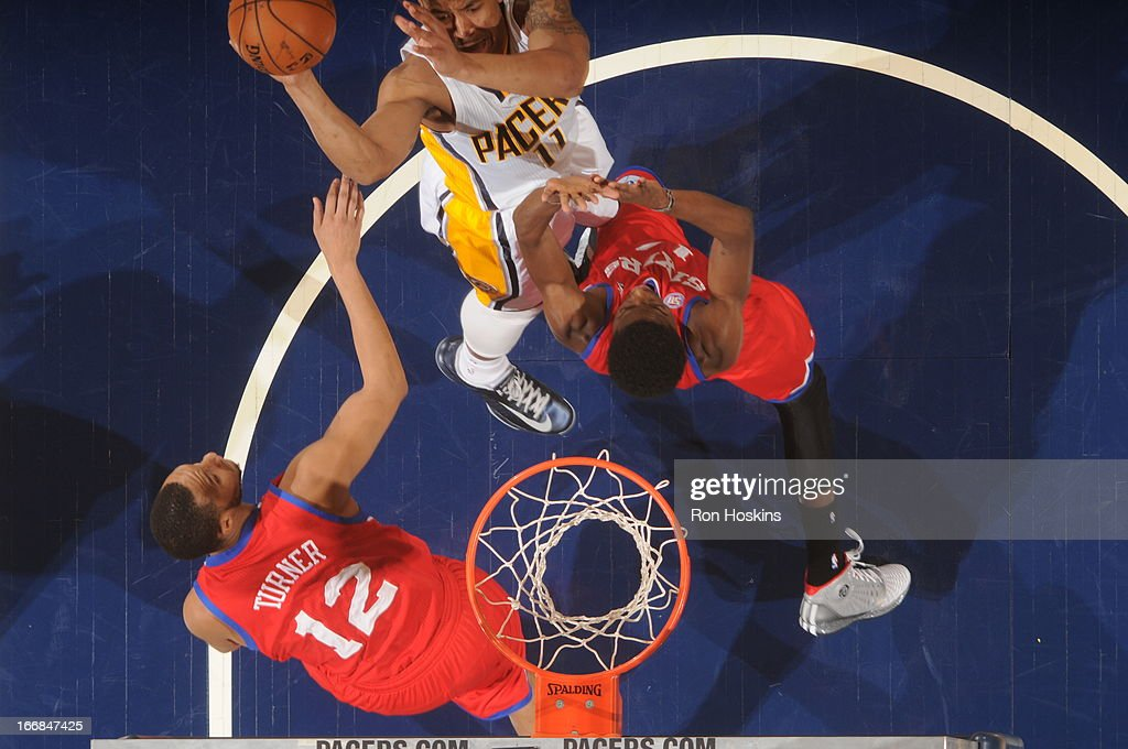<a gi-track='captionPersonalityLinkClicked' href=/galleries/search?phrase=Orlando+Johnson&family=editorial&specificpeople=6849358 ng-click='$event.stopPropagation()'>Orlando Johnson</a> #11 of the Indiana Pacers goes to the basket against <a gi-track='captionPersonalityLinkClicked' href=/galleries/search?phrase=Evan+Turner&family=editorial&specificpeople=4665764 ng-click='$event.stopPropagation()'>Evan Turner</a> #12 of the Philadelphia 76ers during the game between the Indiana Pacers and the Philadelphia 76ers on April 17, 2013 at Bankers Life Fieldhouse in Indianapolis, Indiana.