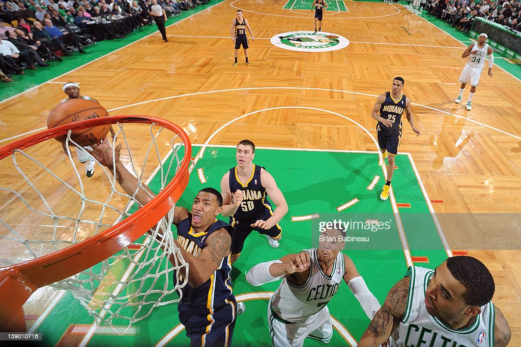 <a gi-track='captionPersonalityLinkClicked' href=/galleries/search?phrase=Orlando+Johnson&family=editorial&specificpeople=6849358 ng-click='$event.stopPropagation()'>Orlando Johnson</a> #11 of the Indiana Pacers goes to the basket against <a gi-track='captionPersonalityLinkClicked' href=/galleries/search?phrase=Jared+Sullinger&family=editorial&specificpeople=6866665 ng-click='$event.stopPropagation()'>Jared Sullinger</a> #7 of the Boston Celtics on January 4, 2013 at the TD Garden in Boston, Massachusetts.