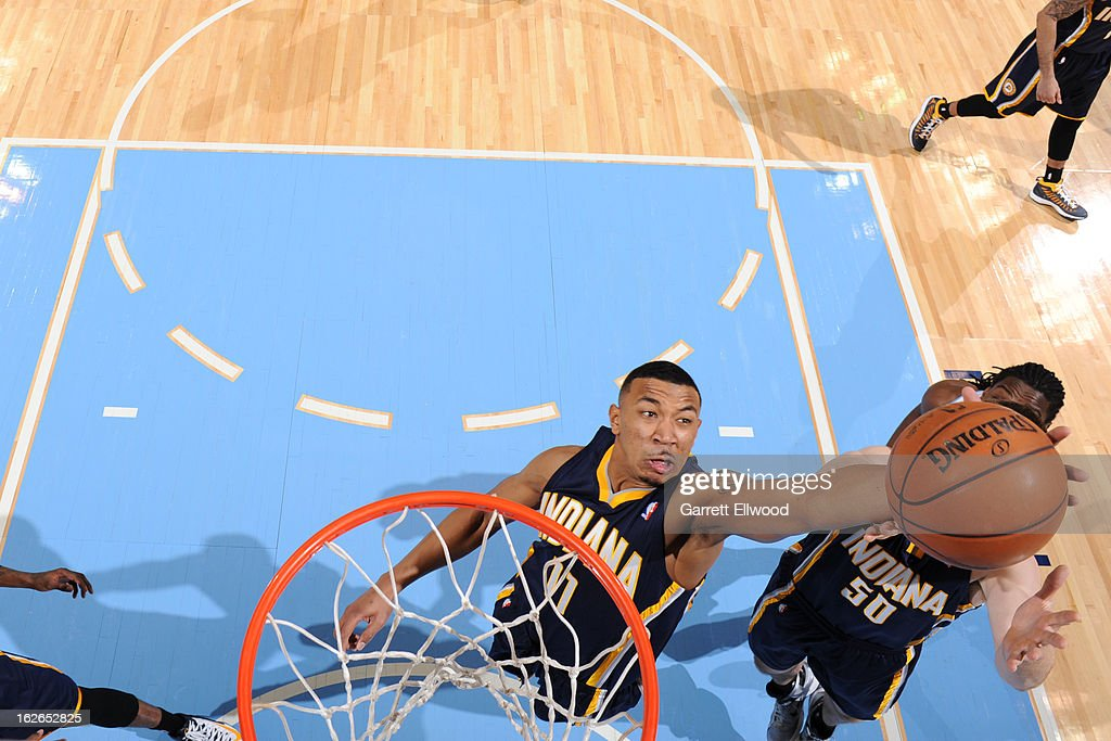<a gi-track='captionPersonalityLinkClicked' href=/galleries/search?phrase=Orlando+Johnson&family=editorial&specificpeople=6849358 ng-click='$event.stopPropagation()'>Orlando Johnson</a> #11 of the Indiana Pacers grabs a rebound against the Denver Nuggets on January 28, 2013 at the Pepsi Center in Denver, Colorado.