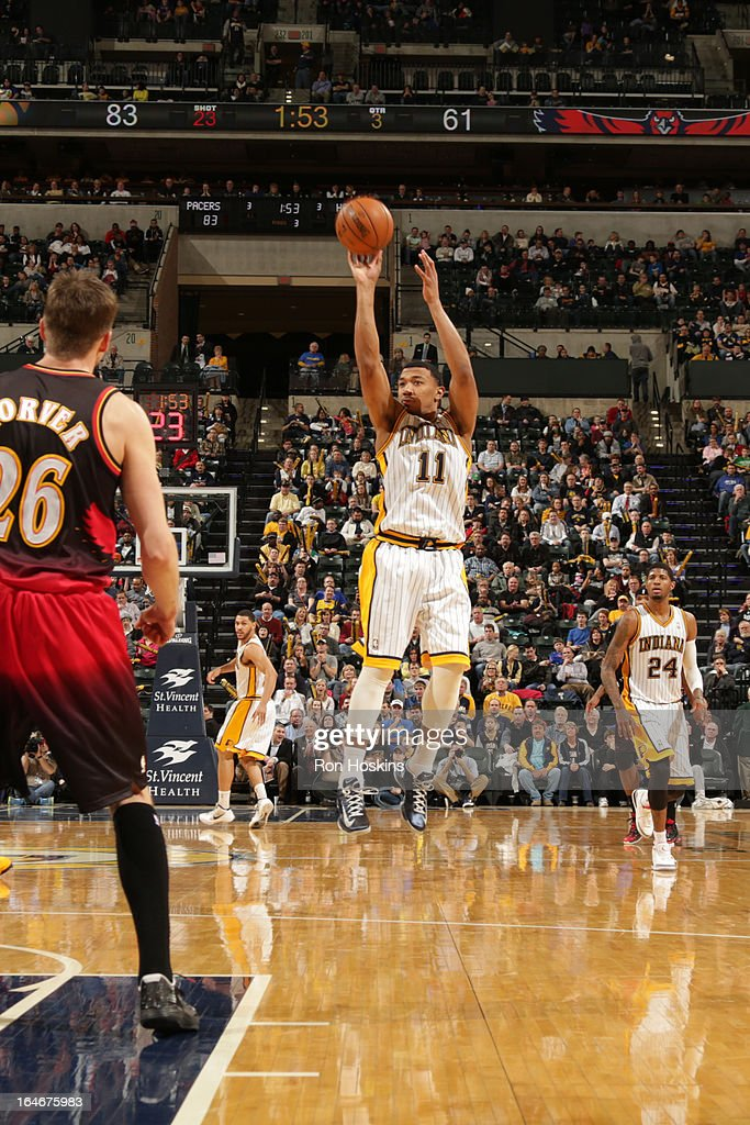 <a gi-track='captionPersonalityLinkClicked' href=/galleries/search?phrase=Orlando+Johnson&family=editorial&specificpeople=6849358 ng-click='$event.stopPropagation()'>Orlando Johnson</a> #11 of the Indiana Pacers shoots a three pointer against the Atlanta Hawks on March 25, 2013 at Bankers Life Fieldhouse in Indianapolis, Indiana.