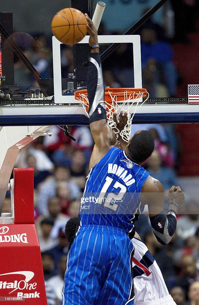 Orlando Magic center Dwight Howard (12) blocks the shot of Washington Wizards shooting guard Nick Young (1) during the first half of their game played at the Verizon Center in Washington, D.C., Wednesday, February 29, 2012.