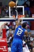 Orlando Magic center Dwight Howard blocks the shot of Washington Wizards shooting guard Nick Young during the first half of their game played at the...