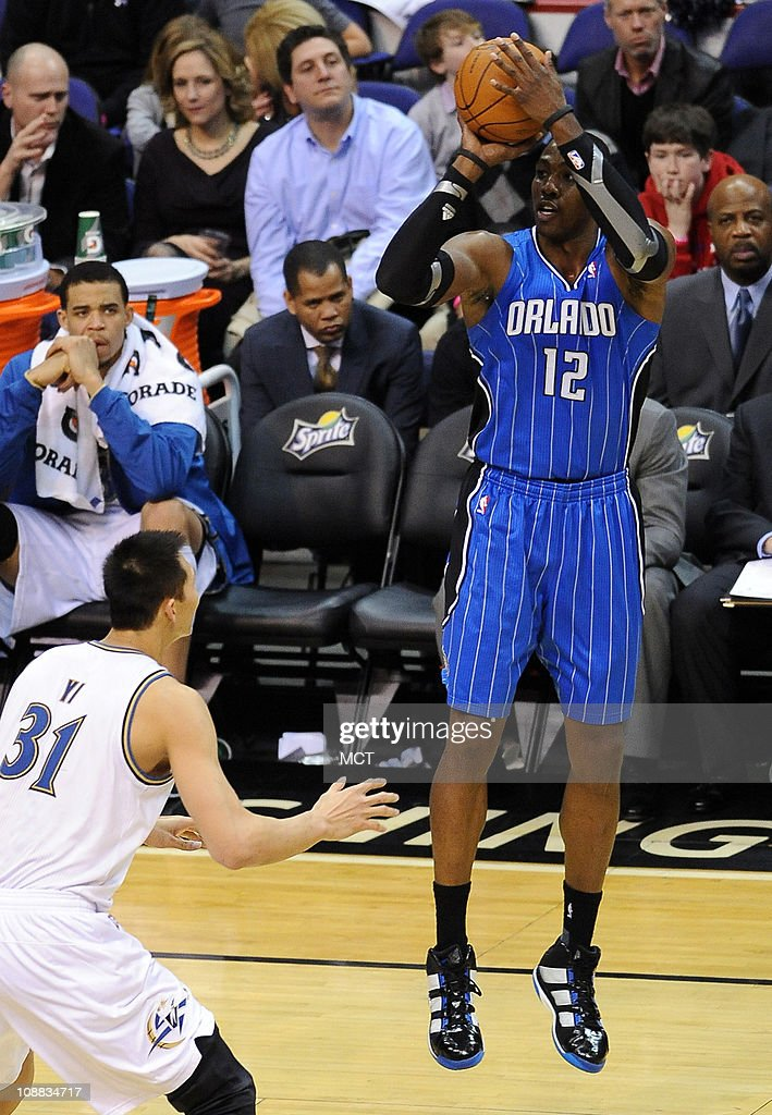 Orlando Magic center <a gi-track='captionPersonalityLinkClicked' href=/galleries/search?phrase=Dwight+Howard&family=editorial&specificpeople=201570 ng-click='$event.stopPropagation()'>Dwight Howard</a> (12) shoots a jumper and scores over Washington Wizards power forward Yi Jianlian (31) during the third quarter at the Verizon Center in Washington, D.C., Friday, February 4, 2011. The Magic beat the Wizards, 110-92.