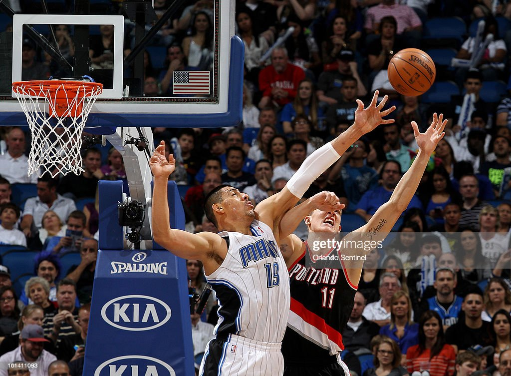 Orlando Magic center Gustavo Ayon, left and Meyers Leonard of the Portland Trail Blazers stretch for a rebound at the Amway Center in Orlando, Florida on Sunday, February 10, 2013.