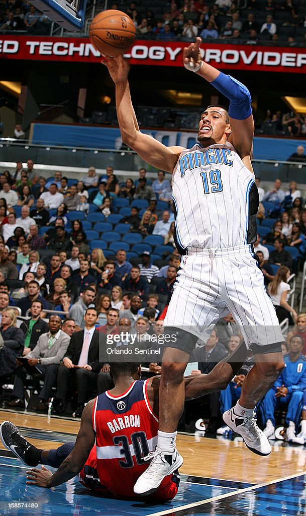 Orlando Magic center Gustavo Ayon (19) stumbles as he pulls down a rebound over fallen Washington Wizards center Earl Barron (30) during an NBA game at the Amway Center on Wednesday, December 19, 2012, in Orlando, Florida.
