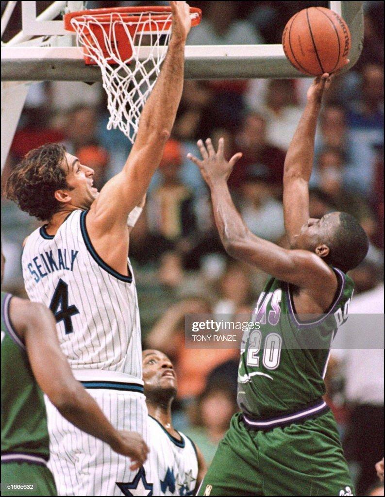 Orlando Magic center Rony Seikaly L blocks a sho