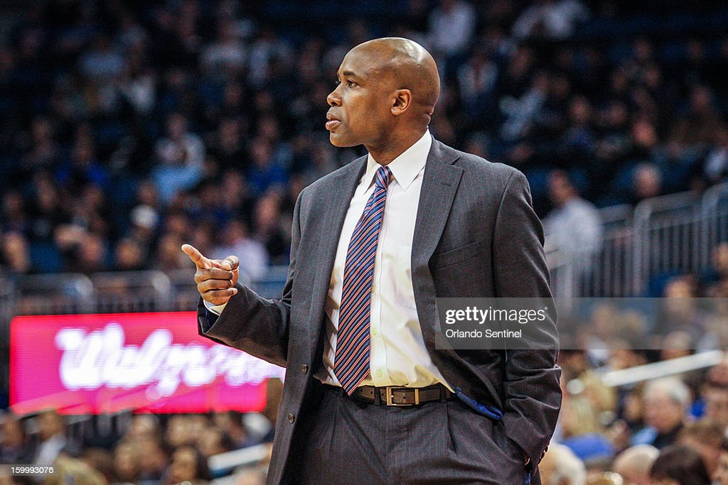 Orlando Magic coach Jacque Vaughn reacts after Glen Davis (11) is called for a technical foul after a confrontation with Toronto Raptors' Aaron Gray (34) during first-quarter action at Amway Center in Orlando, Florida, Thursday, January 24, 2013.