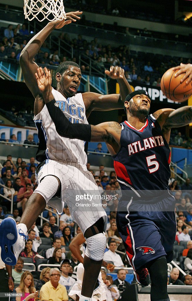 Orlando Magic forward Andrew Nicholson (44) battles Atlanta Hawks forward Josh Smith (5) for a rebound during an NBA game at the Amway Center on Wednesday, December 12, 2012. Atlanta won the game 86-80.