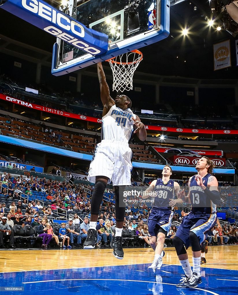 Orlando Magic forward Andrew Nicholson (44) goes up to the basket against the Memphis Grizzlies in the first half of a preseason game at the Amway Center in Orlando, Florida, on Friday, October 18, 2013.