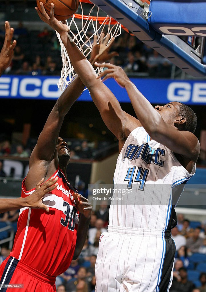 Orlando Magic forward Andrew Nicholson (44) scores over Washington Wizards center Earl Barron (30) during an NBA game at the Amway Center on Wednesday, December 19, 2012, in Orlando, Florida.