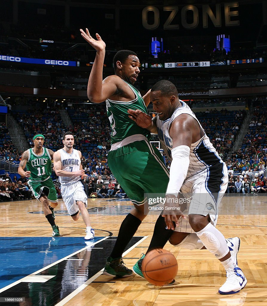 Orlando Magic forward Glen Davis dribbles around Jared Sullinger during their game against the Boston Celtics at the Amway Center on Sunday, November 25, 2012, in Orlando, Florida. The Celtics won the game 116-110.