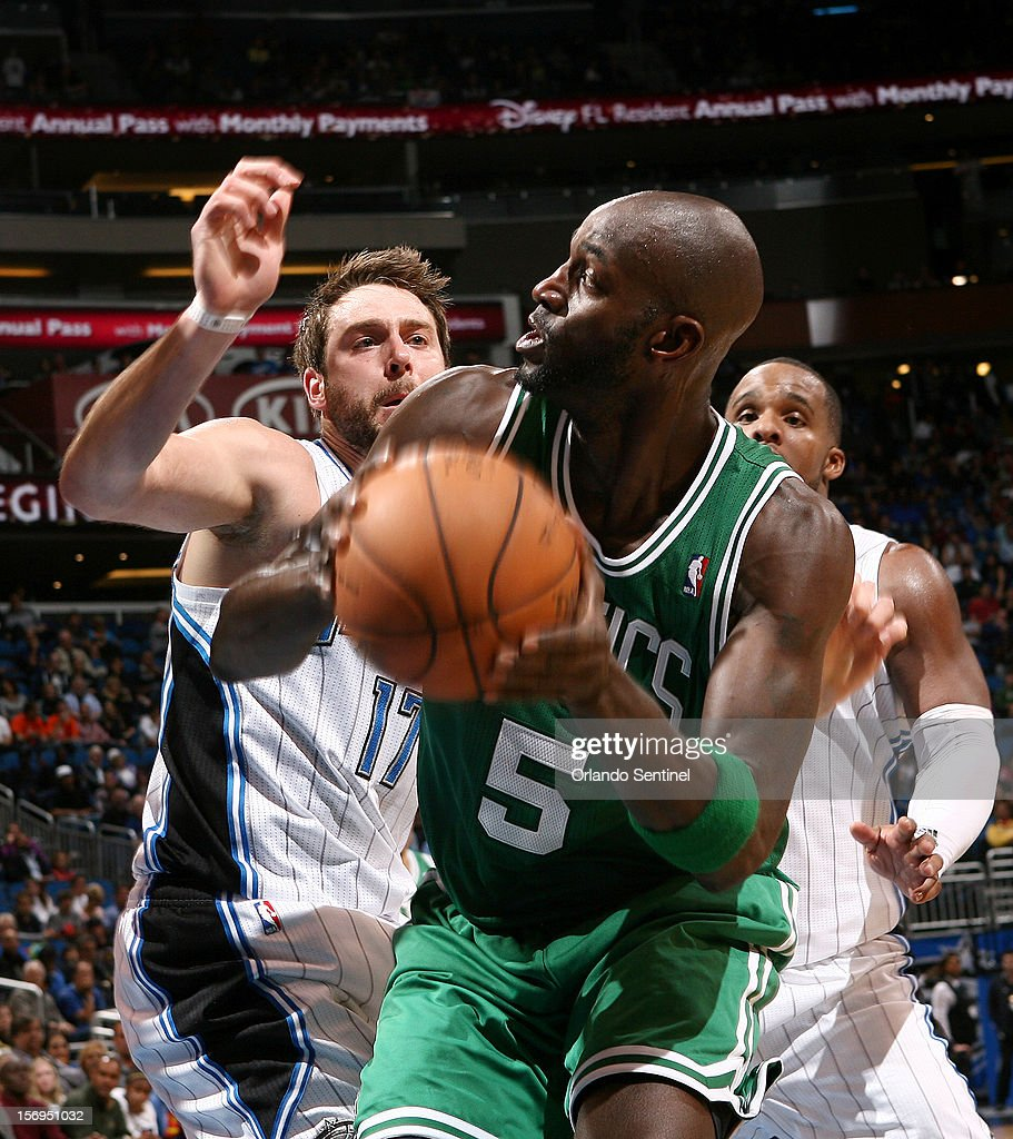 Orlando Magic forward Josh McRoberts defends Kevin Garnett during their game against the Boston Celtics at the Amway Center on Sunday, November 25, 2012, in Orlando, Florida. The Celtics won the game 116-110.