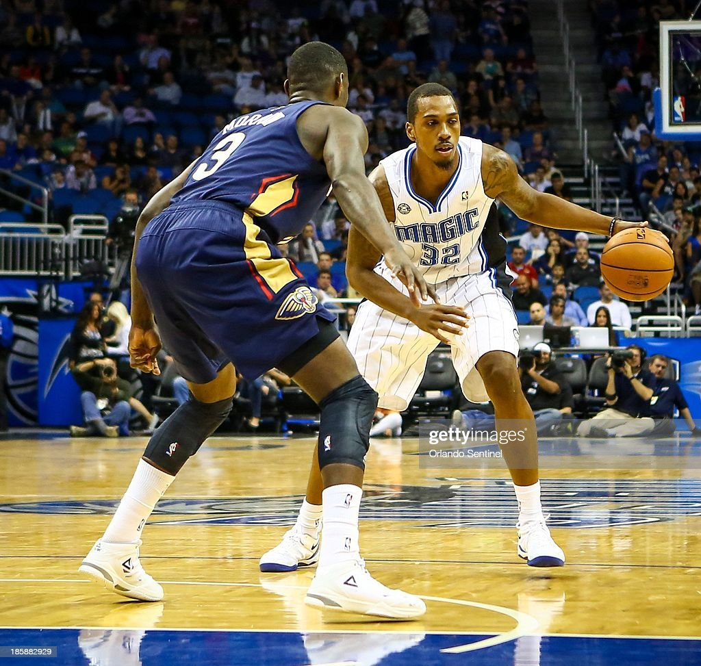 Orlando Magic forward Kris Joseph (32) drives against New Orleans' Anthony Morrow (3) during second-half action of a preseason game at the Amway Center in Orlando, Florida, Friday, October 25, 2013. The Pelicans beat the Magic 101-82.