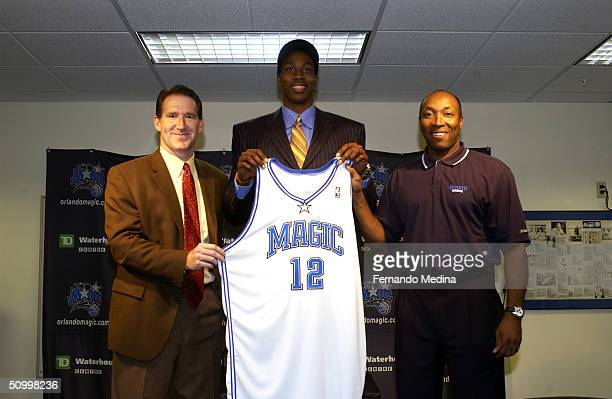 Orlando Magic General Manager John Weisbrod and Head Coach Johnny Davis introduce the first overall pick of the 2004 NBA Draft Dwight Howard to the...