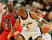 Orlando Magic guard Anfernee Hardaway drives past Miami Heat forward Jamal Mashburn 01 May during the first period of game four of the NBA playoffs...