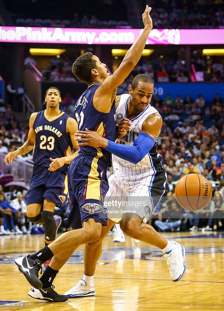 Orlando Magic guard Arron Afflalo collides with the New Orleans Pelicans' Brian Roberts on a drive in the second quarter at the Amway Center in...