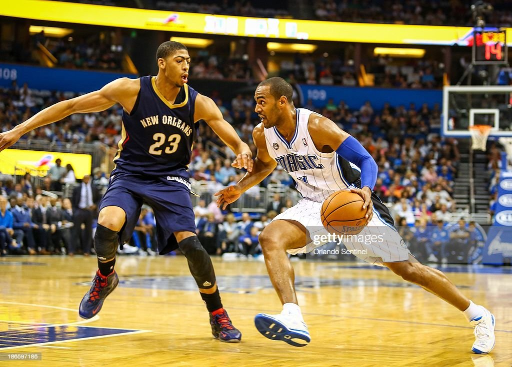 Orlando Magic guard Arron Afflalo drives against New Orleans Pelicans defender Anthony Davis during secondquarter action at the Amway Center in...