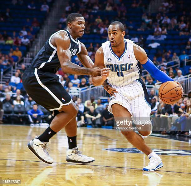 Orlando Magic guard Arron Afflalo drives against the Brooklyn Nets' Joe Johnson in the first quarter at the Amway Center in Orlando Florida Sunday...
