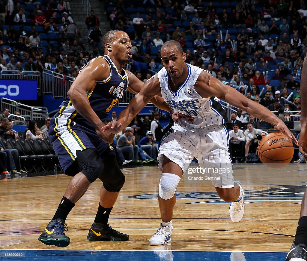 Orlando Magic guard Arron Afflalo drives past Randy Foye during their game against the Utah Jazz on Sunday, December 23, 2012, at the Amway Center in Orlando, Florida. The Utah Jazz defeated the Orlando Magic, 97-93.